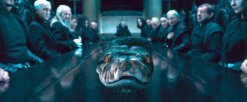 Nagini_at_Malfoy_Manor_Dining_Table